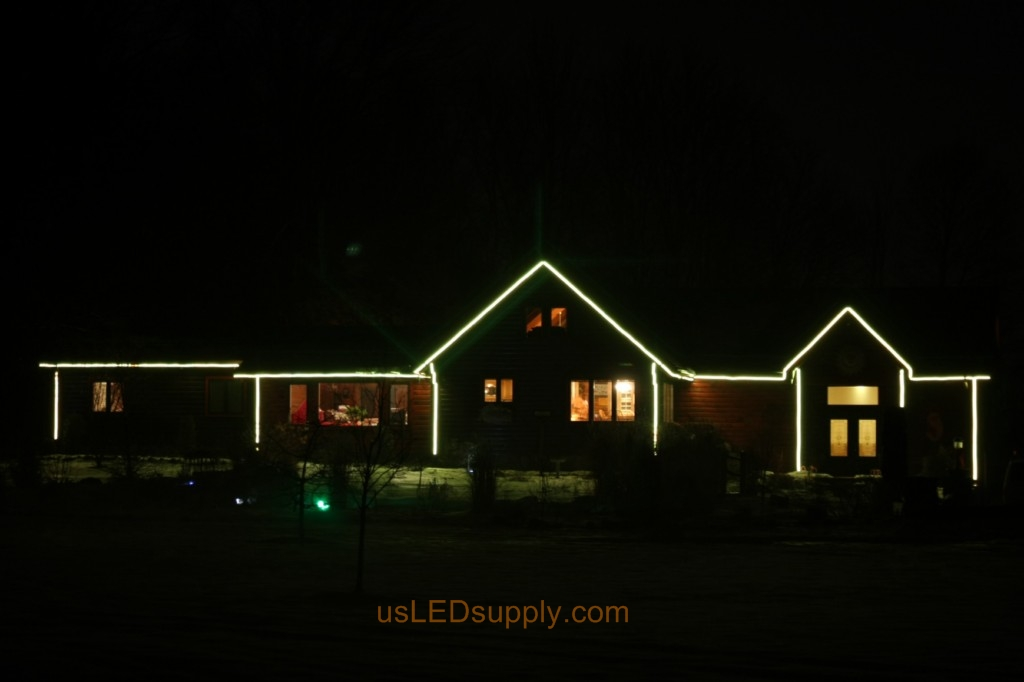 Color changing RGB LED Strips outline a house for all year color.