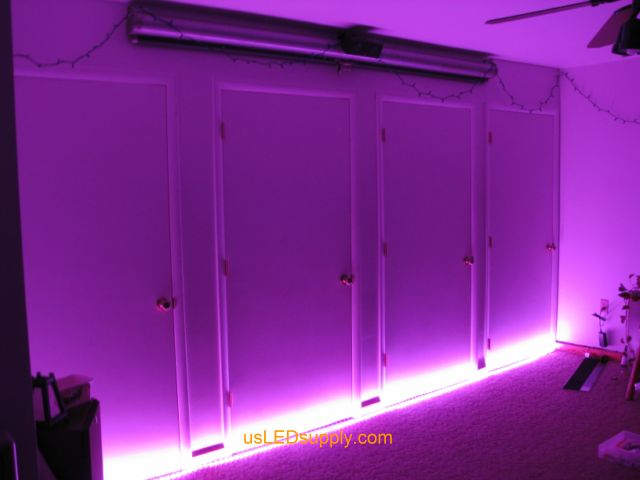 Home theater wall wash rgb led strips light up a home theater area in an apartment mozeypictures