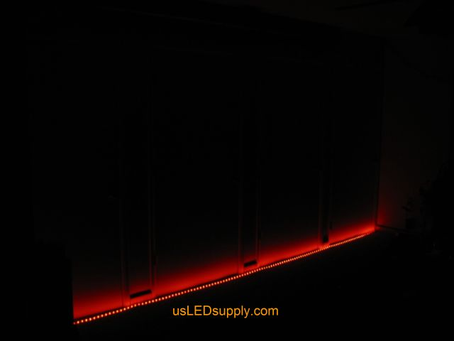 RGB LED strips light up a home theater area in an apartment.
