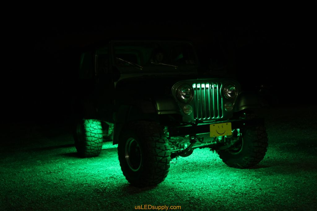 Green Jeep with Green flexible LED strips for undercar lighting effects.