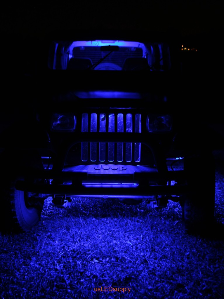 Blue Jeep with blue flexible LED strips under the car and in the grill.