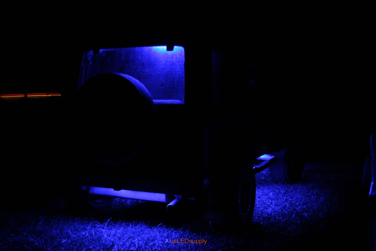 Blue Jeep with blue flexible LED strips for undercar lighting effects.