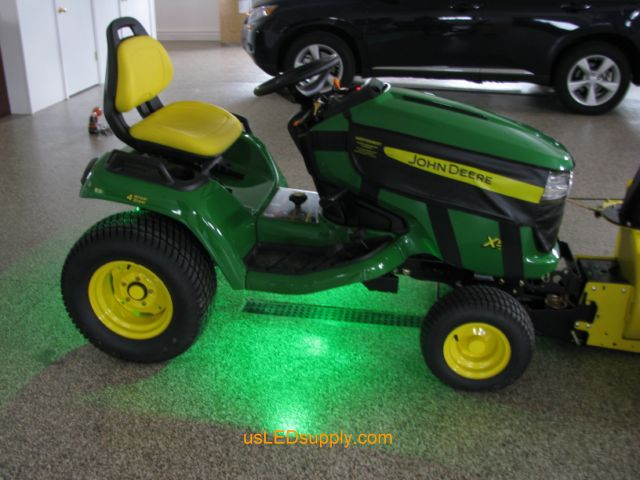 John Deere Tractor with green LED Modules lighting up the ground.