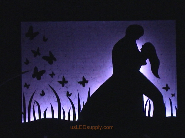 RGB LED silhouette art project with couple in love.