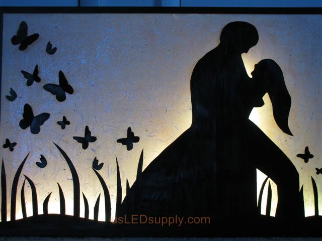 RGB LED silhouette art project with couple in love set on white color.