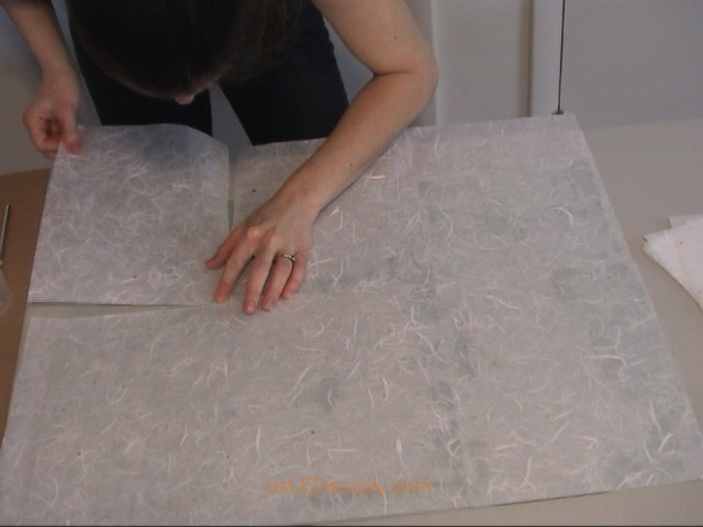 Match up the corners of the paper so that there are no gaps (or buy a larger sheet of paper to cover the entire glass).