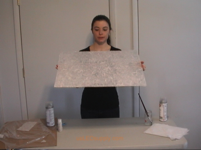 Transluscent mulberry paper is now covering the entire piece of glass.