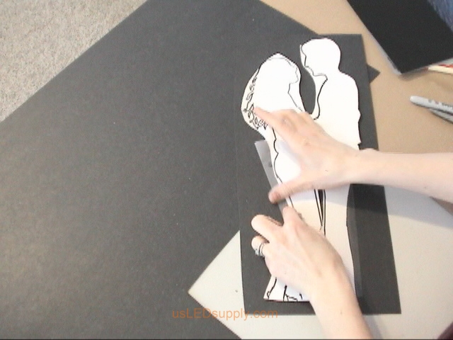 Cut out roughly around the couple and tape it to a piece of medium thickness poster board.