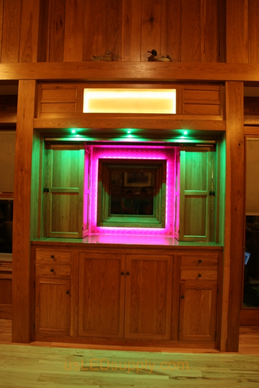 RGB LED Strips illuminate a window overlooking a lake.