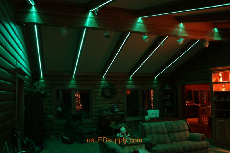 Livingroom with RGB Flexible LED Strips set on teal green color
