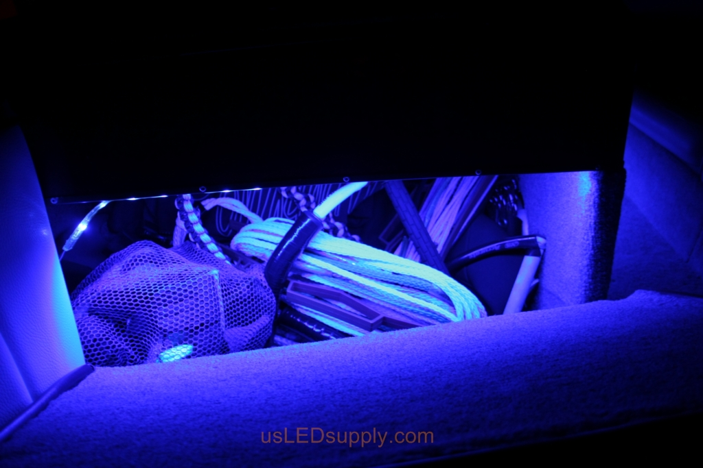 RGB LED lights inside a storage compartment on a malibu sunsetter makes it easy to find your stuff.