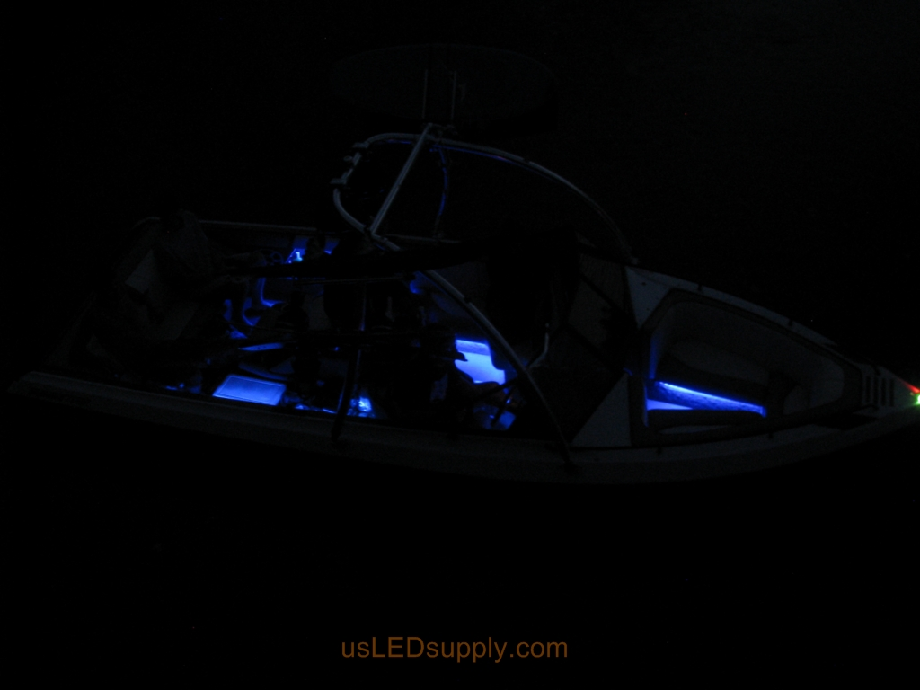 Malibu Sunsetter Boat on the water at night with RGB color changing LEDs lighting up the interior.
