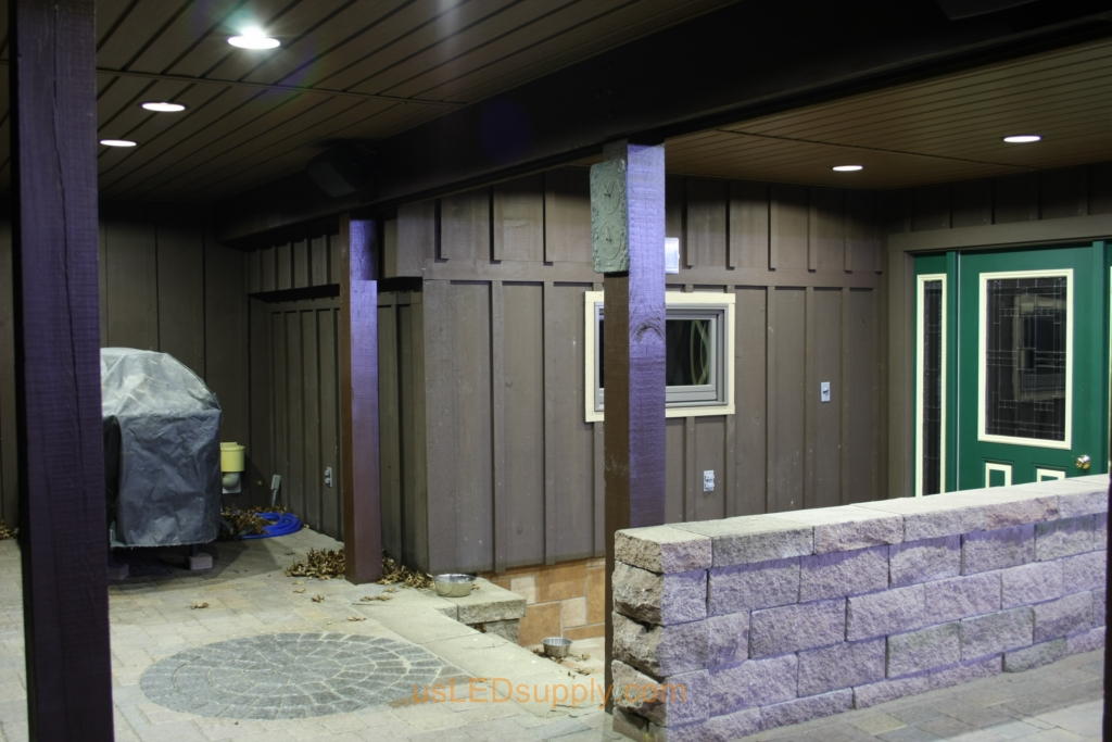 Recessed white LED lighting helps to light up this covered outdoor walkway patio area.