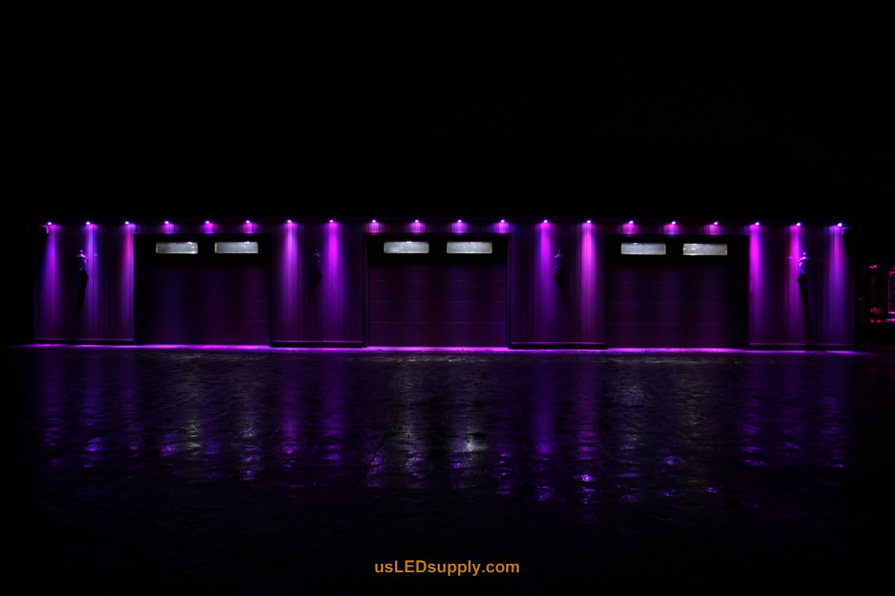 RGB Puck Lights outside of a garage set on purple color.