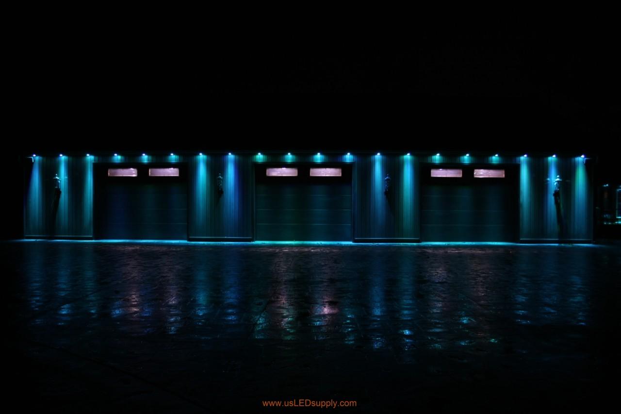 RGB Puck Lights outside of a garage set on light blue.