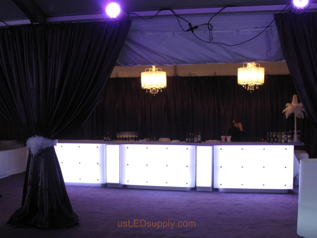 Bar glows with LED strip lighting.