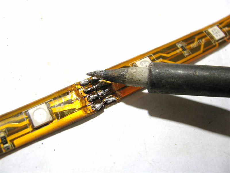 With the flex strips touching each other end-to-end, match the color code letters on both strips and solder the wires to the end of the second strip, forming a bridge.