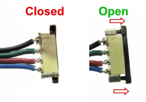 Open splice connector by pulling the black piece outward