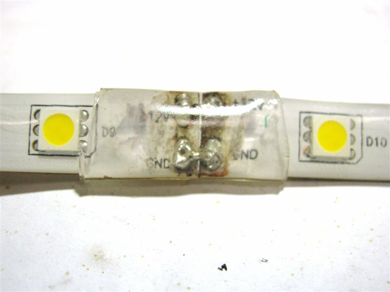 Single color flexible LED strip to strip Solder connection covered with hot glue and heat shrink tubing.