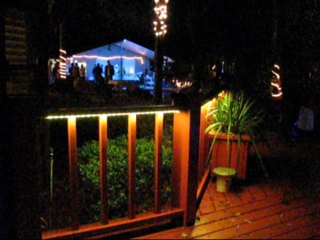 led deck lights on during an outdoor dinner party