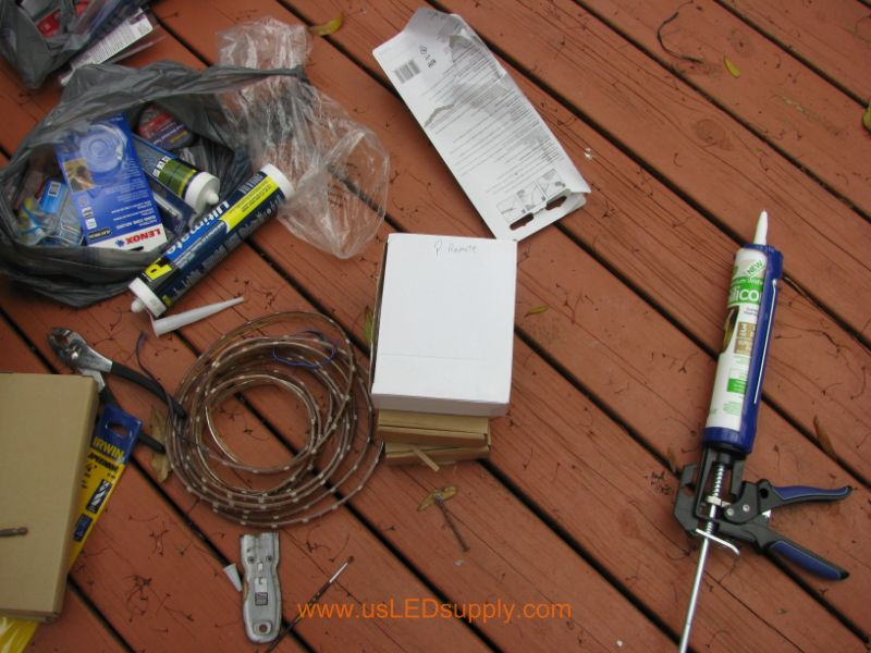 All of the materials laid out for deck lighting project.