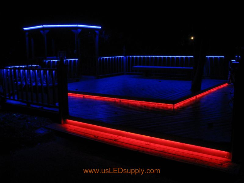 RGB Flexible LED Strips lighting up an outside deck - they are still bright although they are dimmed down in this picture.