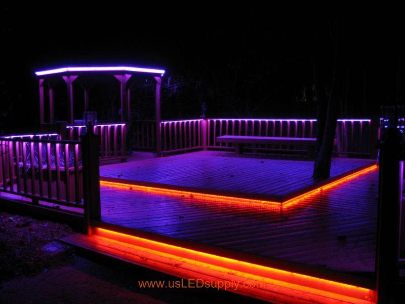 RGB Flexible LED Strips lighting up an outside deck changing colors.