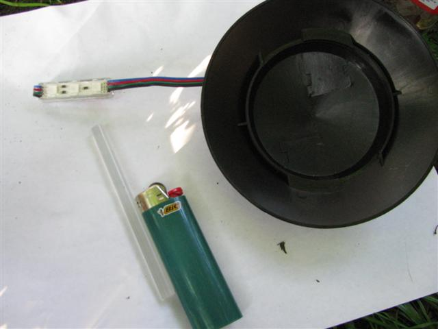 RGB LED module, garden path light cap, hot glue stick, lighter.