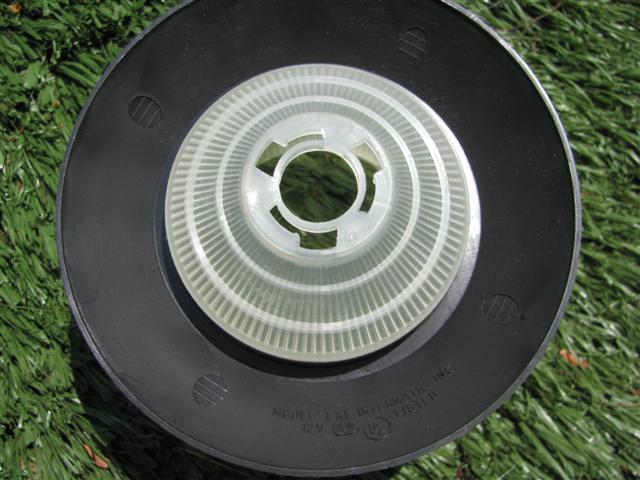 The bottom shade on the garden light.