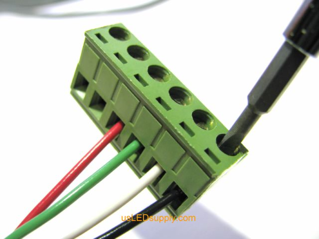 Insert wires into terminal block in the correct order and tighten down the screws above the wires.