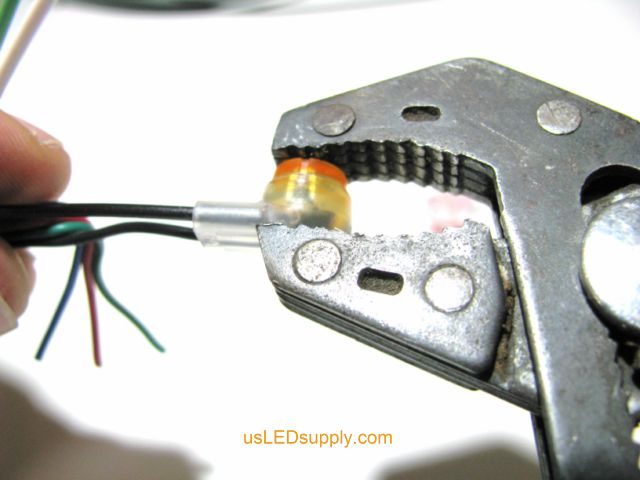 With wires fully inserted, crimp the butt connector with channel-lock or robo-grip type pliers
