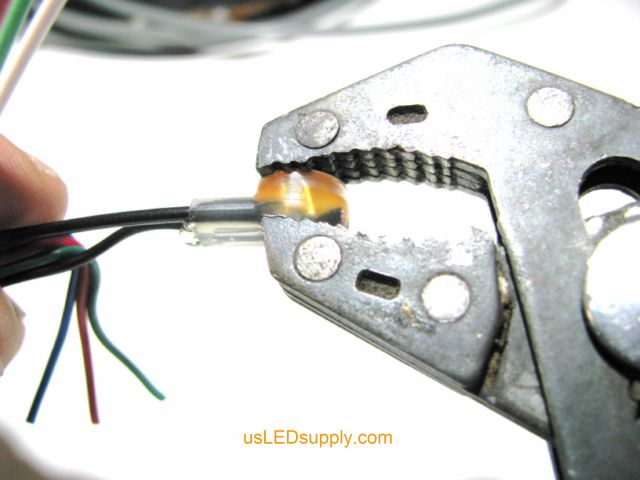 Crimping the butt connector to connect the black wires