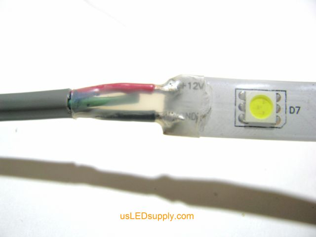 Cover solder connection with heat shrink tubing